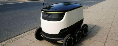 Роботы и люди на улицах гётеборга